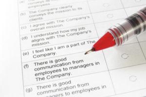 pen on employee satisfaction survey